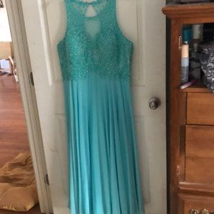 Teal floor-length prom/formal dress.